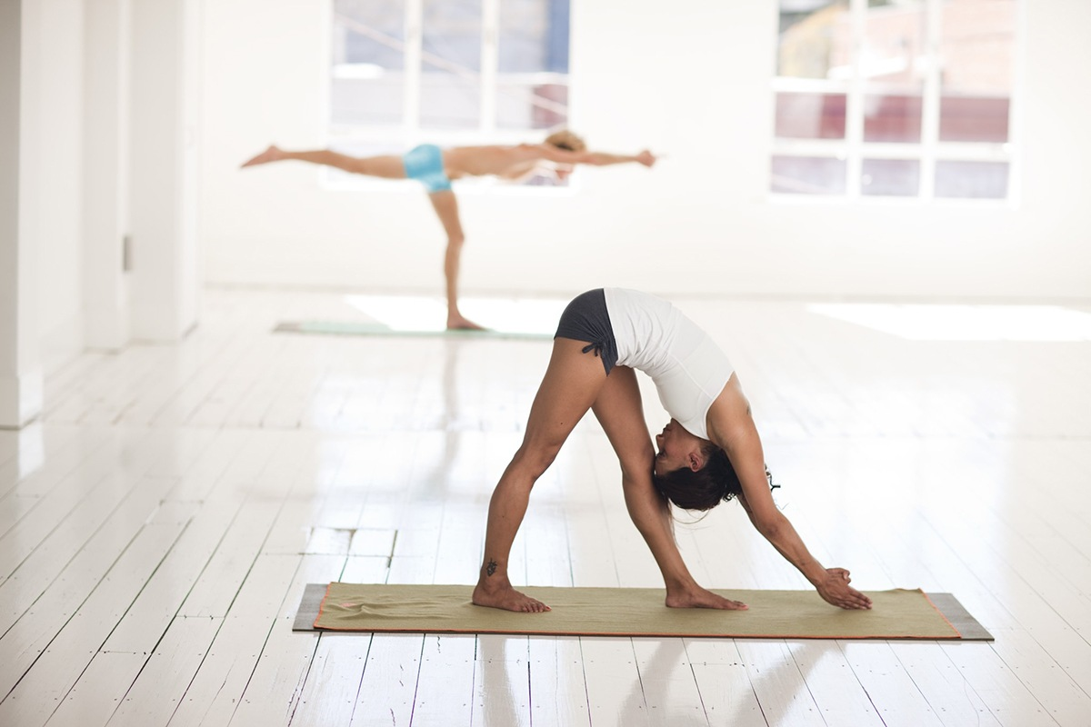 Canva - Women Stretching In Yoga Session Class
